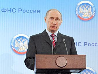 Путин отвел четыре месяца на списание налоговых долгов