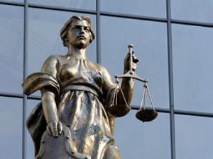 За совершение ряда тяжких преступлений под суд пошла банда из 17 человек