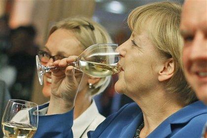 Блок Меркель выиграл выборы в Германии