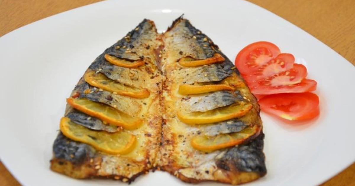Рецепт к праздничному столу: Запеченная рыба в духовке со сливками и сыром